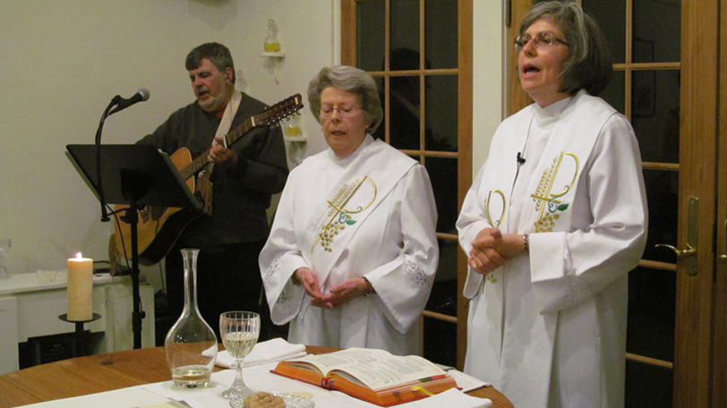 Marie, Ann, & Jim at Eucharist